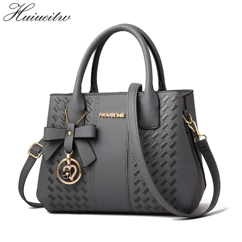 HUIUEITW moda donna borse borse in pelle PU borsa a tracolla con tracolla ricamata a mano borsa a mano stile semplice da donna